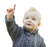 Little Boy bonito na camiseta que aponta no branco Fotografia de Stock Royalty Free