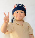 Little Boy with Bonnet Showing Peace Hand Sign Royalty Free Stock Photos