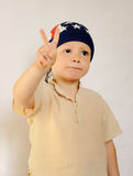 Little Boy with Bonnet Showing Peace Hand Sign Royalty Free Stock Images