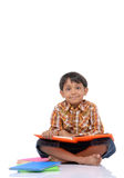 Little boy with book. Adorable child student a over white background Royalty Free Stock Photo