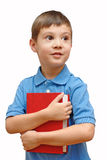 Little boy with book Stock Images