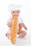 Little baker baby girl with a long loaf Stock Photo
