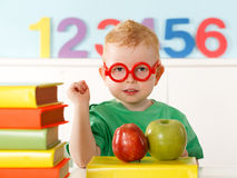 Little genius with books for reading Stock Photography