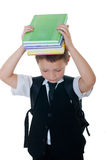 Little boy with books on head on white background Royalty Free Stock Photo