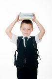 Little boy with books on head on white background Royalty Free Stock Photography