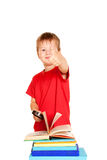 The little boy with books and magnifying glass. Student showing a thumbs up or OK sign. Isolated on white background Royalty Free Stock Photos
