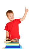 Little boy with books pointing up Royalty Free Stock Image