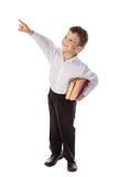 Little boy with books pointing up to empty space Stock Images