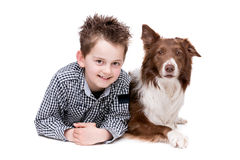 Little boy and a border collie Stock Images