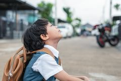 Little boy boring to go to school in morning. Kids students having boredom in depress emotion. People and Lifestyles concept. Education and Back to school royalty free stock photo