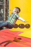 Little boy on a bouncy castle Royalty Free Stock Photos