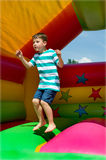 Little boy on a bouncy castle Royalty Free Stock Photography