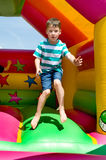 Little boy on a bouncy castle Royalty Free Stock Images