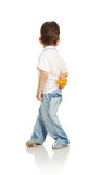 The little boy with a bouquet of the yellow colors Stock Photos