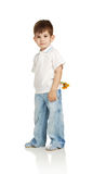 The little boy with a bouquet of the yellow colors Royalty Free Stock Photos