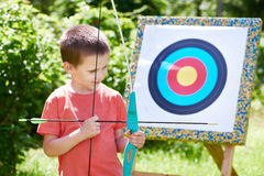 Little boy with bow near sport aim Royalty Free Stock Image