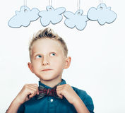 Little boy in the bow tie with cartoon clouds on white Stock Photography