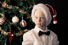 Little boy in a bow tie celebrating Christmas Stock Image