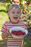 Little boy with bowl of raspberry Stock Photo