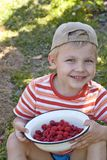 Little boy with bowl of raspberry Royalty Free Stock Photo