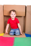 Little boy in a box Royalty Free Stock Photography