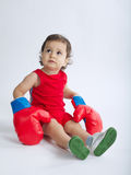 Little boy with boxing gloves Stock Images