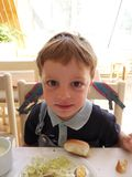 Little boy at a breakfast tables Royalty Free Stock Photo
