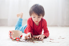 Little boy, breaking his piggy bank to buy gift for mother's day Royalty Free Stock Image