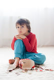 Little boy, breaking his piggy bank to buy gift for mother's day Stock Photography
