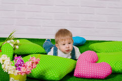 Little boy with bright colors and spring flowers Stock Image