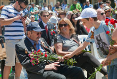 Little boy brings flowers to WWII veteran Royalty Free Stock Photos