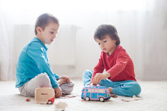 Little boy brothers, breaking their piggy bank to buy gift for m Stock Photography