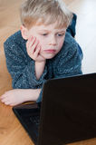 Little boy browsing the interent Royalty Free Stock Photos