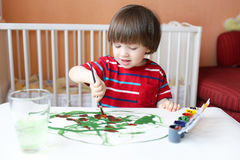 Little boy with brush and gouache Royalty Free Stock Photography