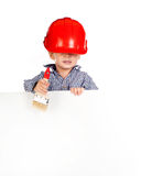 Little boy with a brush in the helmet with banner Stock Photo