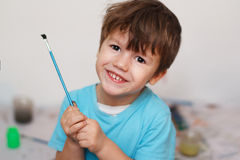 Little boy with brush Royalty Free Stock Photo