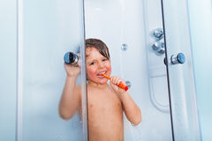 Little boy brush teeth with toothbrush in shower Stock Images