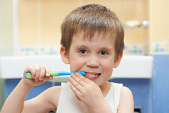 Little boy brushing his teeth Stock Image