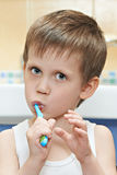 Little boy brushing his teeth Stock Photos