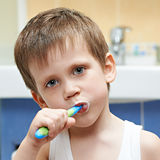 Little boy brushing his teeth Stock Images