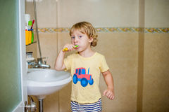 Little boy brushing his teeth in the bathroom Stock Photo