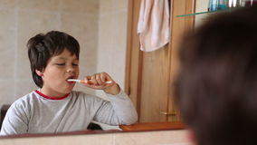 Little boy brushing teeth. Selective focus stock video footage