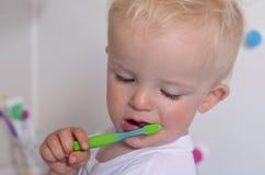 Little boy is brushing teeth Royalty Free Stock Photo