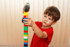 Little boy build tower from blocks Royalty Free Stock Images