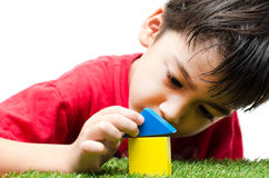 Little Boy Building A Small House With Colorful Wooden Blocks Royalty Free Stock Image