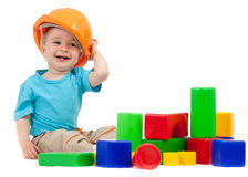 Little boy with building blocks. Little boy with hard hat and building blocks Stock Photo
