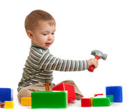 Little boy with building blocks. Little boy with tools and building blocks Royalty Free Stock Images