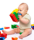Little boy with building bricks Stock Images