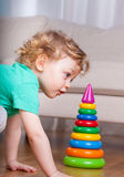 Little boy building plastic tower Stock Image