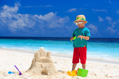 Little boy building sand castle on beach Royalty Free Stock Photo